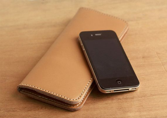 A beautiful hand made designer phone wallet.  It is made with custom design, and solid crafting.
