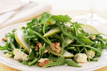Rocket, pear, walnut & blue cheese salad 2 tsp Honey  ⅓ C Extra virgin olive oil  1 tbsp White wine vinegar  2 Pears  3 C Rocket leaves  100 g Blue cheese  ¾ cup Walnuts  Mix honey,extra-virgin olive oil and white wine vinegar. Remove cores from the pears and slice thinly,leaving skin on. Place pears in a bowl and pour over the dressing. Combine rocket leaves,crumbled blue cheese and lightly toasted walnuts on a serving. platter.Scatter salad with ripe pears.