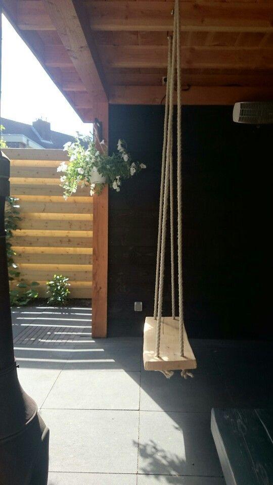 Schommel op de veranda.