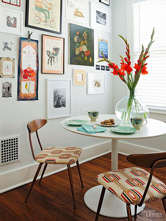 Subtlety is essential to midcentury design. Small details, like geometric seat pads, elevate basic dining chairs with understated wishbone backs. An array of vintage artwork adds interest around the Saarinen-inspired tulip table.