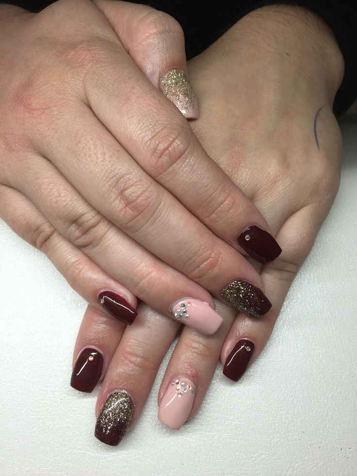 OPI Burgundy and nude/pink polish. Gold accents, short ballerina/coffin shape