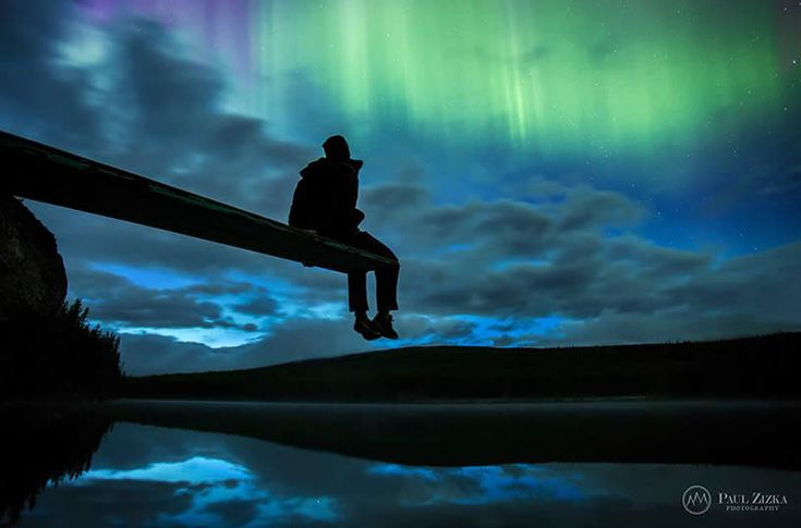 """Illusion: Canadian landscape photographerPaul Zizka """"enjoys the challenge of capturing nature's beauty at night, and the unique features that come with a dark sky—stars, Northern Lights and dramatic silhouettes."""" [1] He is also known for taking pictures of hard-to-reach places like up on mountains, as well as other remote rural areas. 1."""