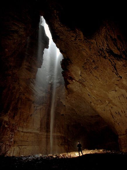 Awesome cave with rays of light illuminating this grand space.