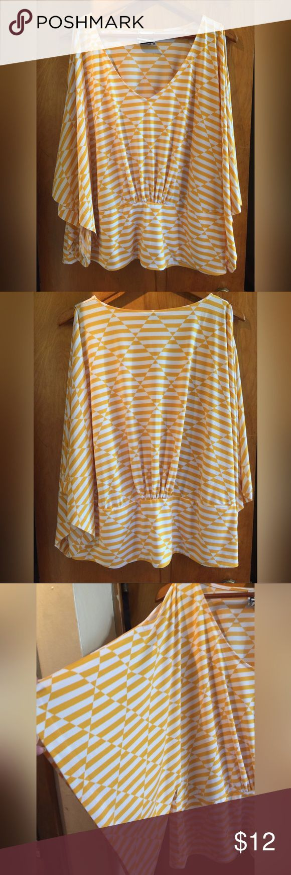 Cold shoulder top Yellow and white knit top. Cold shoulder top with batwing sleeves. There is an elastic gathering the back. Very cute. Very good condition Tops