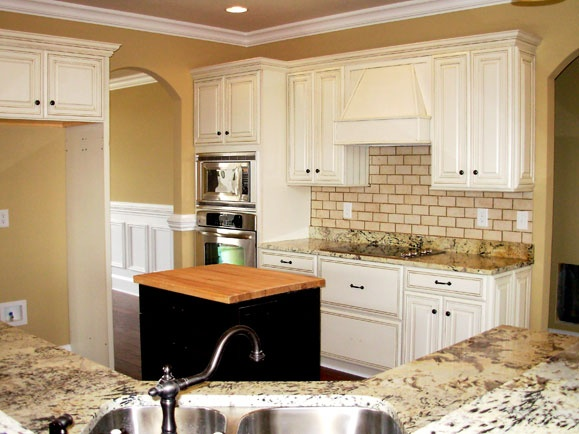 White glazed cabinets distressed hardwood floors and for Distressed kitchen cabinets