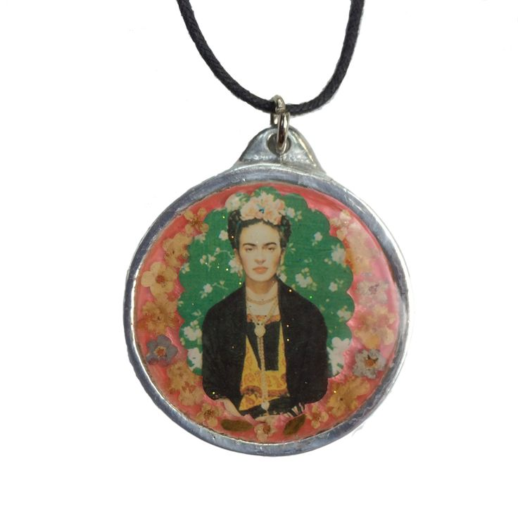 Frida Kahlo necklace with flowers set in resin and pewter. http://lasninastextiles.com/product/frida-kahlo-necklace-with-flowers/
