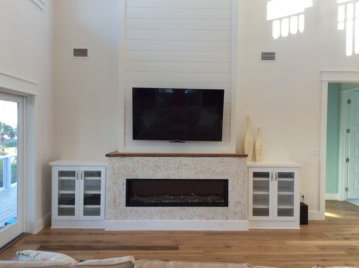 Not finished yet MantleMount tv above linear fireplace tabby stucco  Reiss Beach House