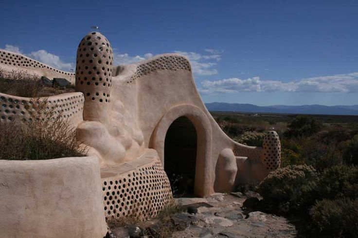 Earthship homes are made from bottles, tires, and cans, that are filled with mud, installed, and then plastered over with mud.