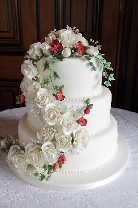 Emily Wedding Cake decorated with a waterfall of sugarcraft flowers.