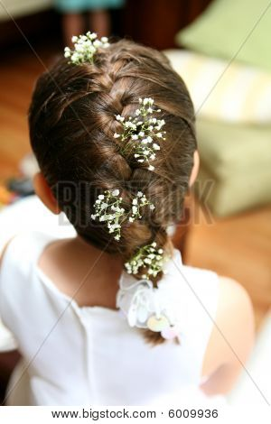 french braid  | Flower girl at wedding with french braid and baby's breath in her hair ...