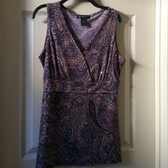 Macy's INC Sleeveless empire waisted jersey top Jersey purple and silver bling empire waisted top . Macy's International Concepts - medium Petite.  It is hard to tell from this picture how cute this top is.  It's purple, lavender paisley and has twinkling rhinestones all over it.  I'm a petite so it's a little long waisted for me. INC International Concepts Tops Blouses