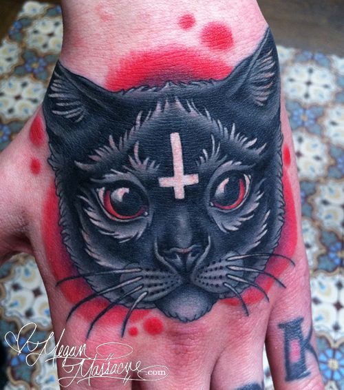 I made this cat head tattoo on my boyfriend Joe Letz's hand at the Wooster Street Social Club!