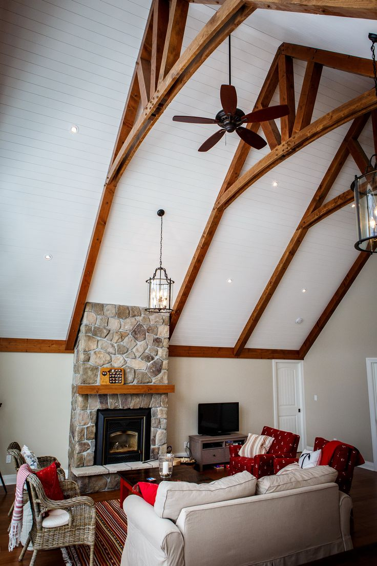 Carling Bay Cottage - Interior - Great Room - Stained Ceiling Bents - Custom Stone Fireplace