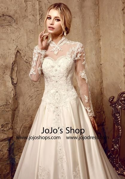 Thisgorgeous modest laceball gown wedding dress classic and elegant, with lace illusion neckline back, long lace sleeves, edged with lace appliques. Romantic