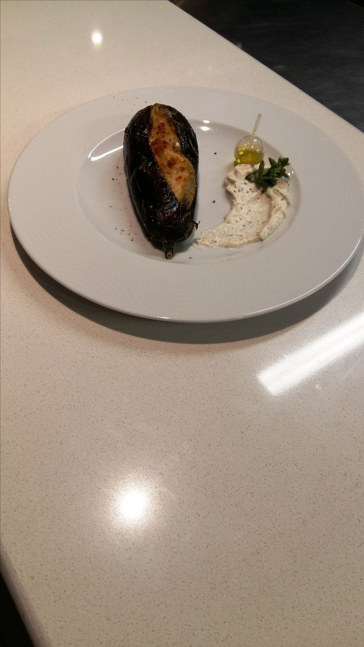 Imam with minced beef - Eggplant stuffed with Santorinian cherry tomatoes, bechamel, onions, variety of peppers, garlic, Feta cheese and minced beef meat. Santorini Weddings, Wedding venue, Wedding ceremony and reception, Sunset view, wedding menu.