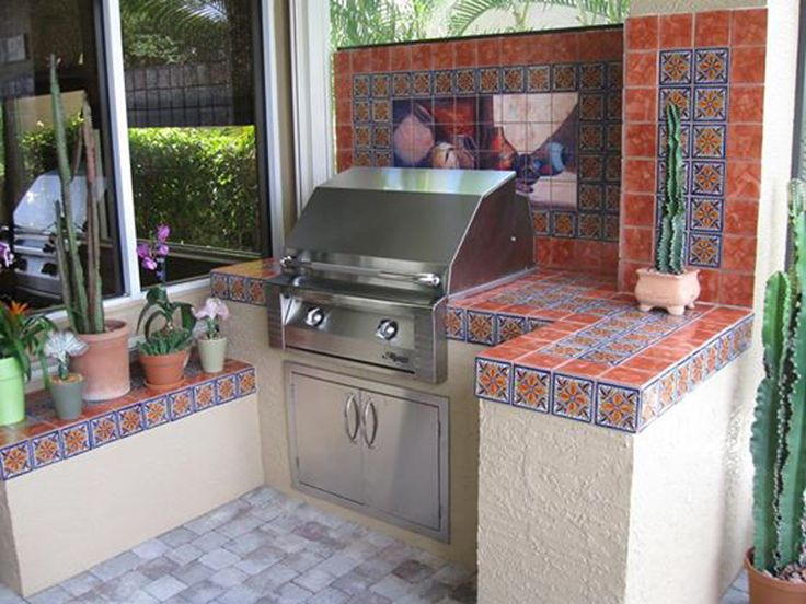 Featured Artist: Ritch Gaiti. Beautiful Southwestern Tile Mural set behind outdoor kitchen!