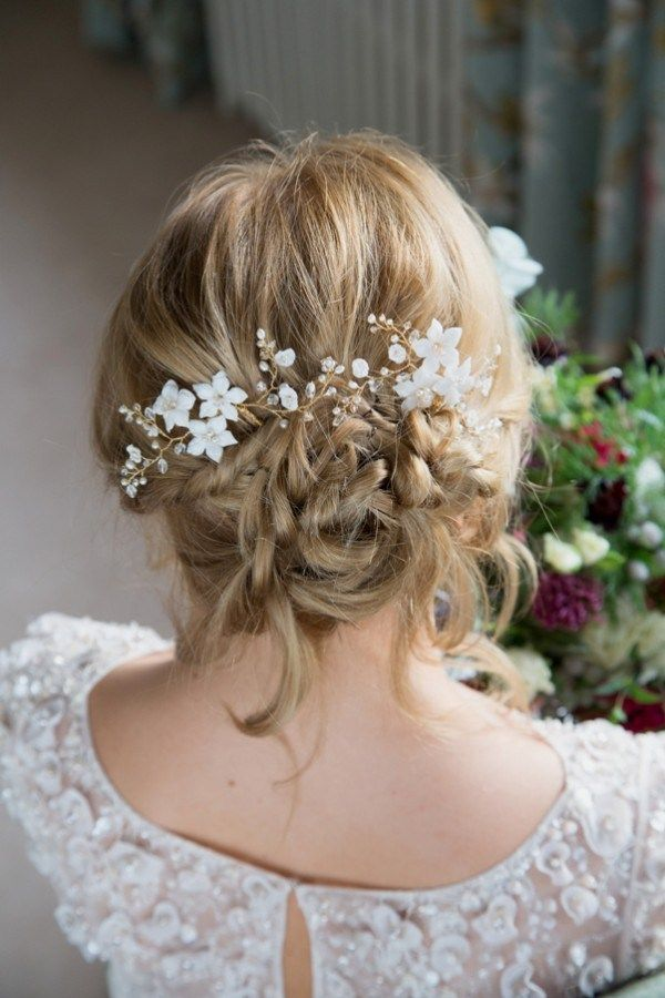 Clematis Hairpins by Laurel Lime Bridal. A precious pearl and crystal wedding hairpin that winds romantically in a vine like arrangement harmonised by a trio of handmade ivory flowers.