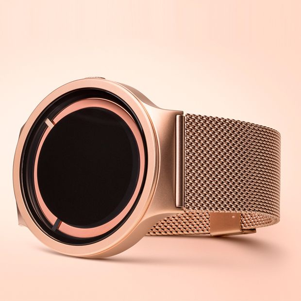 Two rectangular markers replace conventional hour and minute hands and seem to float above the luminescent ring. One marker is slightly larger than the other, which enables them to pass over each other and to differentiate between hours and minutes. #watches #design