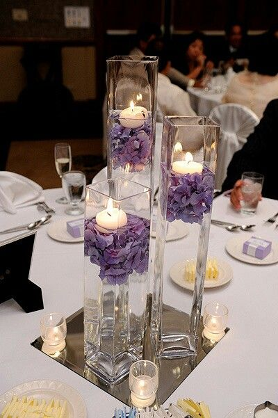 Centerpieces with flowers and floating candles...Love