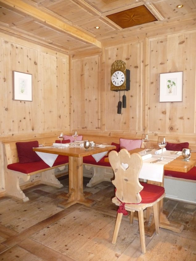 Wood paneled dining room in romantic boutique hotel in Swiss mountains.