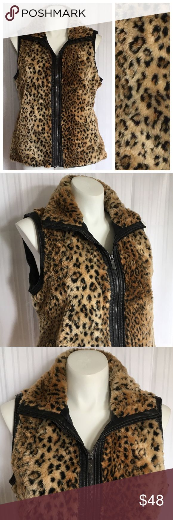 "🎉JUST IN🎉 Vegan faux fur leopard print zip vest Vegan faux fur leopard print zip vest. Plus size XL from East 5th. Bust 48"", waist 46"" (fits like an 18/20). Like new condition. 🚫No holds 🚫No Lowball Offers 🚫No Trades ✅Please submit reasonable offers via the offer button or 🎁 bundle & save! East 5th Jackets & Coats Vests"