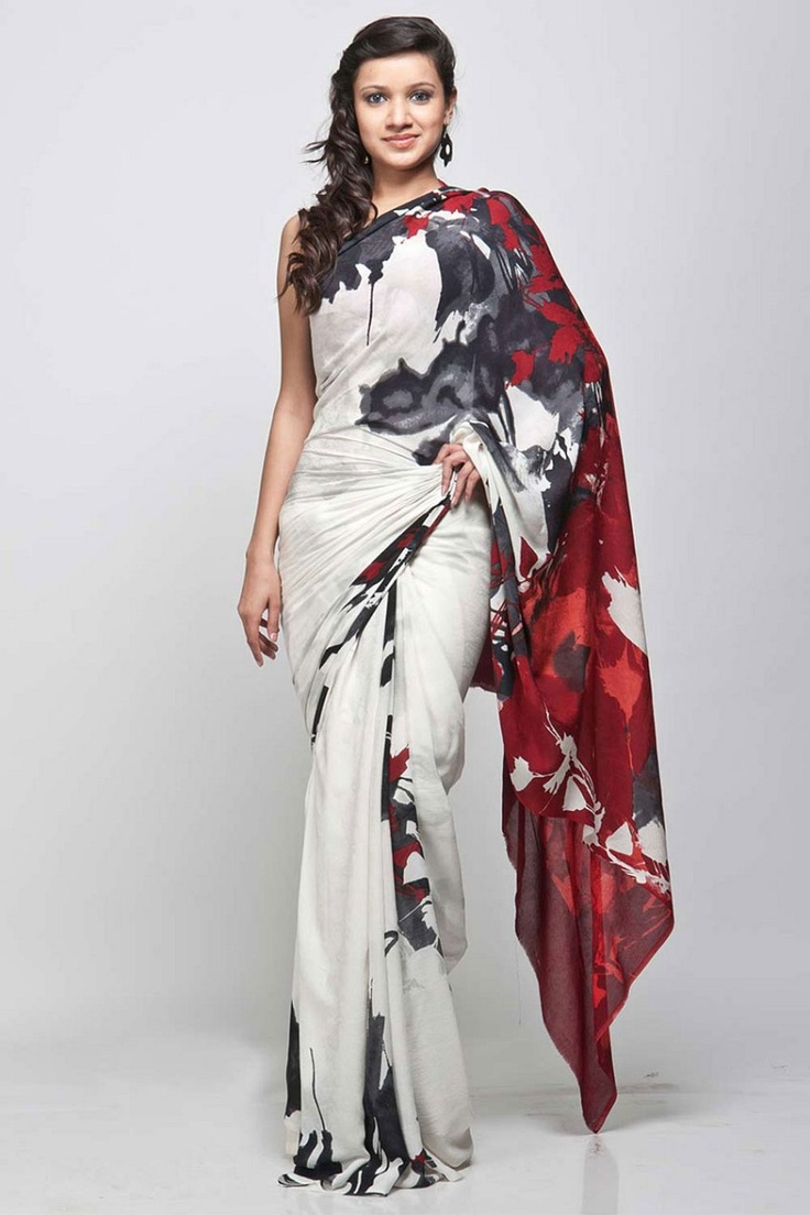 A white and black ,abstract screen printed saree ,with a red palla by Satya Paul.