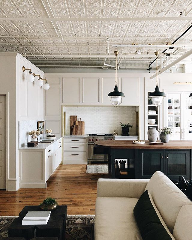 open kitchen and living room // large island // black cabinets ...