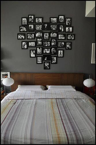 Great idea for newlyweds bedroom on a budget!  Ikea frames sprayed any color you please and candid snapshots!