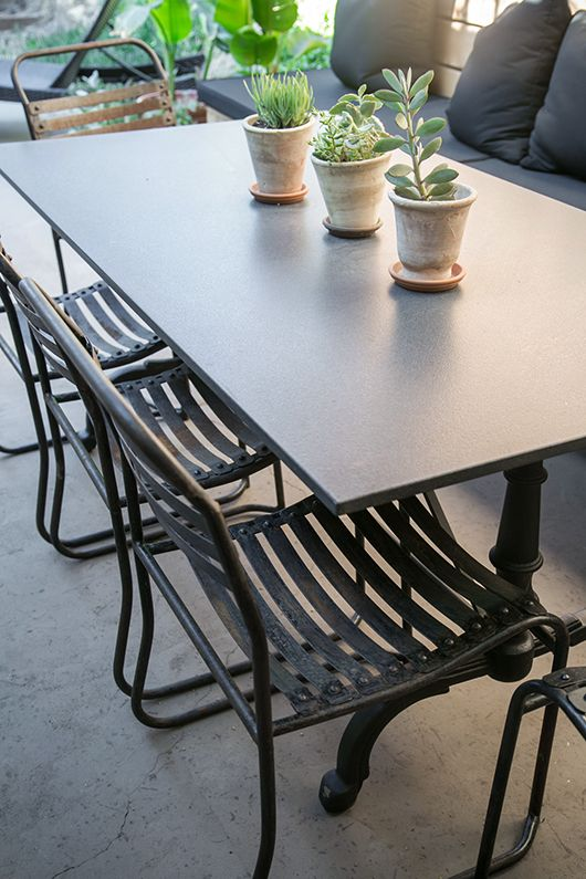 potted succulants on granite outdoor dining table / sfgirlbybay  chairs from CDI Furniture