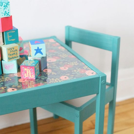 Get the scoop on this fun, colorful IKEA hack - a perfect little kids table and chairs for your little one's room or nursery!