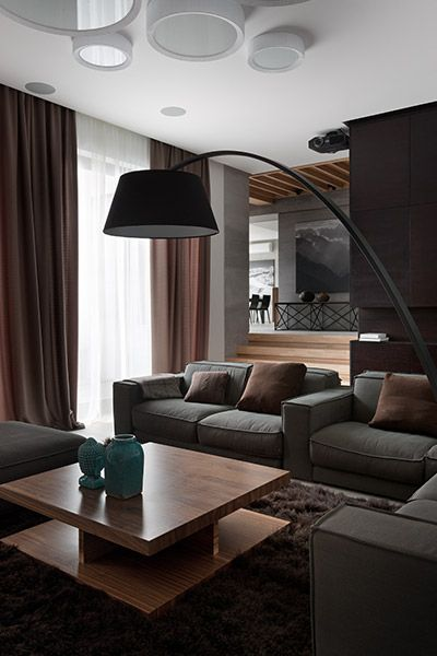 Modern living room design with stylish neutral color palette in redesigned family home Ukraine