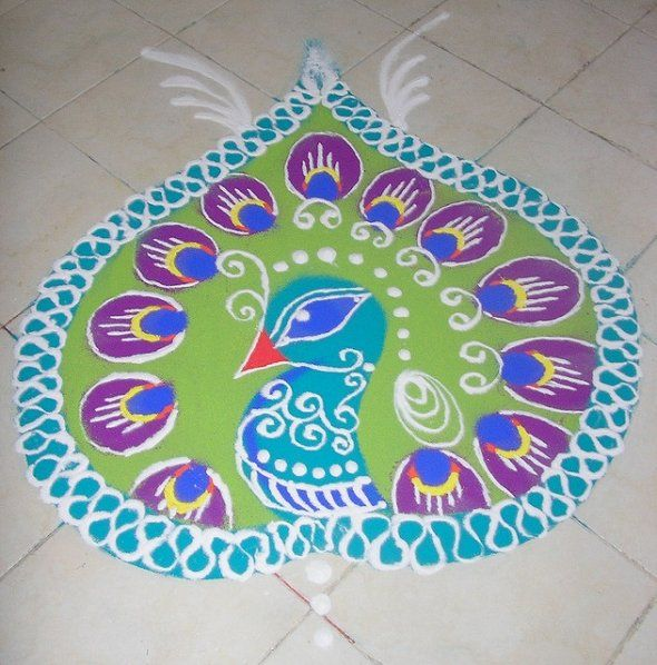 Peacock Rangoli- I've made one very similar to this one. I wonder how N feels about peacocks?