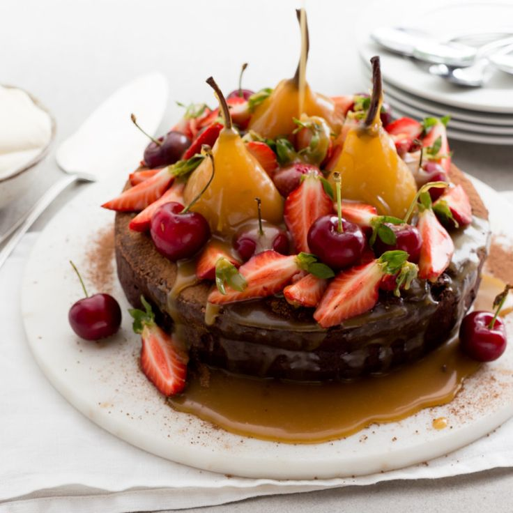 Chocolate fudge cake with poached pears and salted caramel