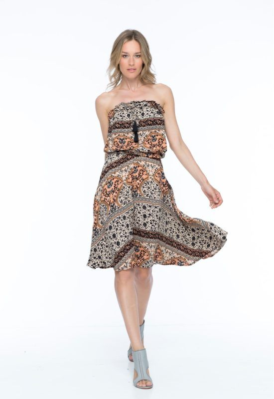 JADE MIDI DRESS --  Cut out of a vintage inspired handmade print, the dress is fitted with an elastic band around the bust and waist for an effortless chic evening look.