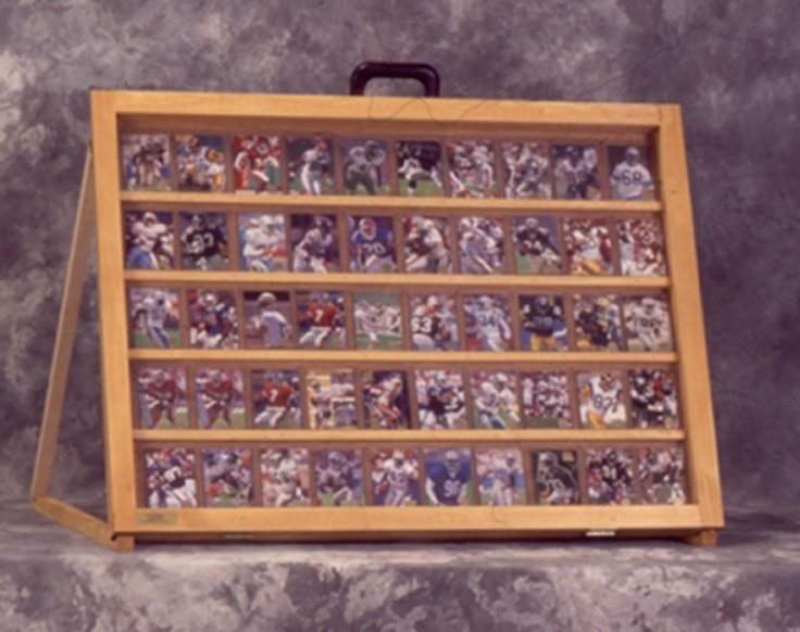 baseball card display case | http://images.monstermarketplace.com/sport-memorabilia-display-cases/1-2-tabletop-baseball-card-display-case-golden-oak-800x633.jpg