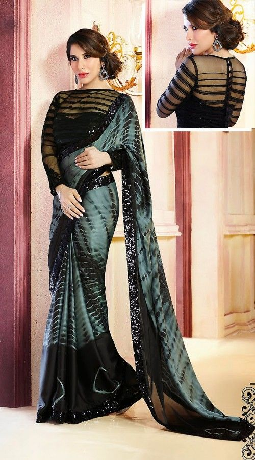 Modelled by Sophie Choudry, this Exclusive greyish blue satin and georgette border saree which is ornamented with sequins work on the border. Matching blouse piece attached with this attire. The blouse of this saree can be stitched in the maximum bust size of 42 inches.