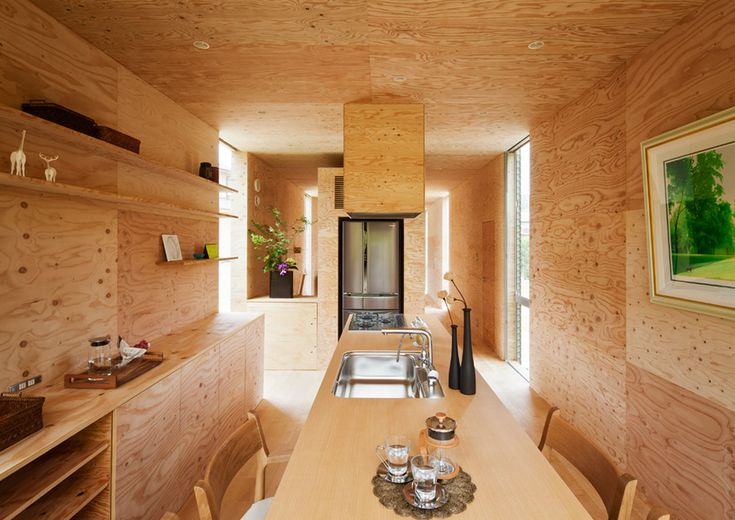 This Japanese house was built on a sloped plot of land that's partially in the forest so they cantilevered one volume over another like building blocks.