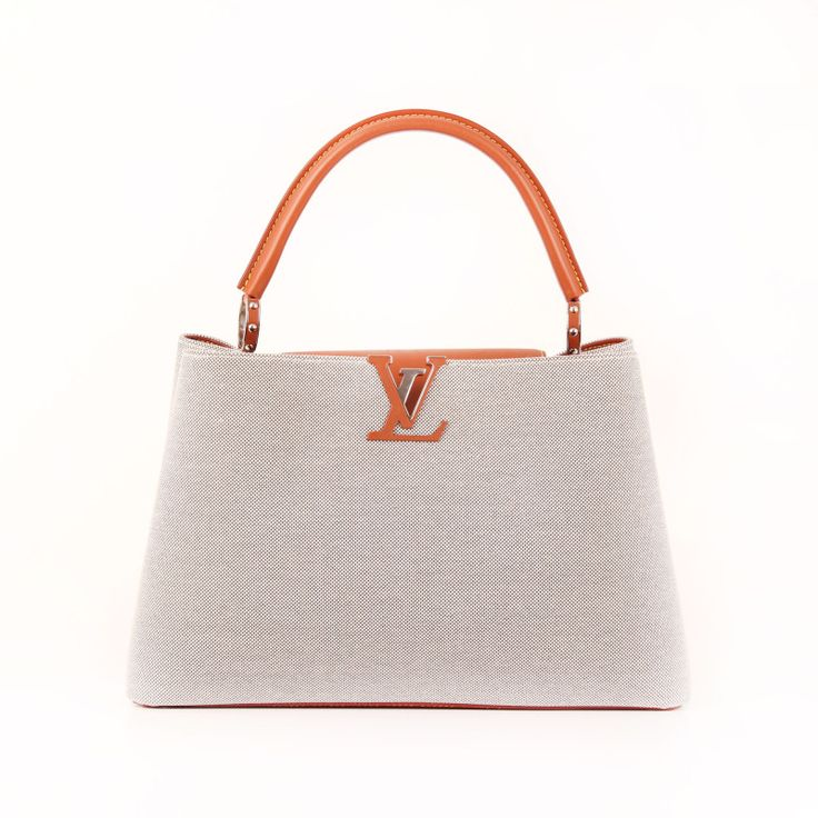 Louis Vuitton Capucines MM Mateo leather and cotton canvas.