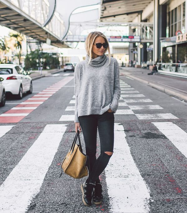 For a casual, slouchy style, we recommend wearing a baggy polo neck sweater over ripped black jeans like Janni Deler. Combine the look with a pair of patent sneakers and a leather tote bag to really recreate this cool and casual style.Jeans: Anine Bing, Sweater/Shoes: Me & The Met, Bag: Celine.