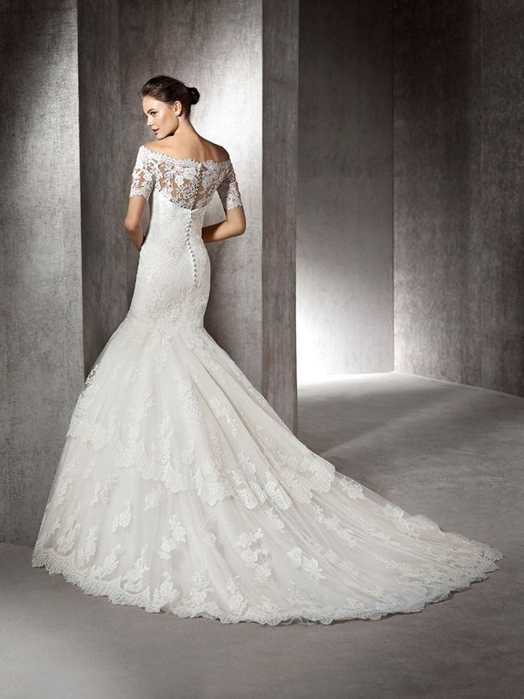 ZAINALA - Tulle wedding dress with lace and guipure appliqués. Sweetheart bodice with off-the-shoulder sheer overlay. Full mermaid skirt with frills.
