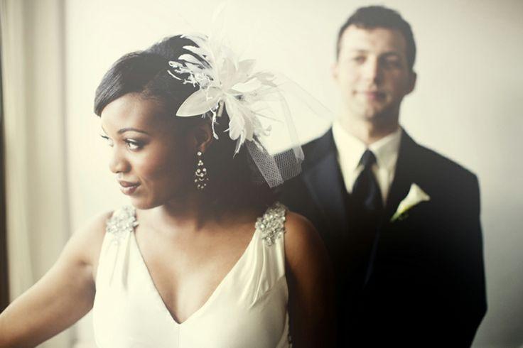 http://weddingnouveau.com/2010/07/real-interracial-wedding-susan-mark-photogen-inc-part/