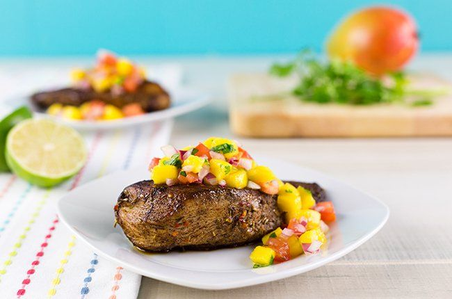 Recipe: Caribbean Jerk Chicken with Mango Salsa. We used a jerk sauce instead of a rub, but this recipe was AMAZING. had it with black beans and yellow rice.