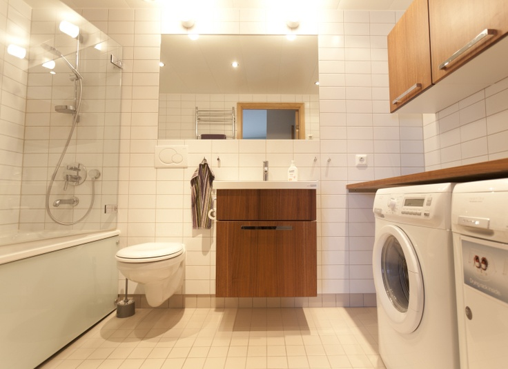 Combining a laundry room with a bathroom, pantry, or other area can save space and money.