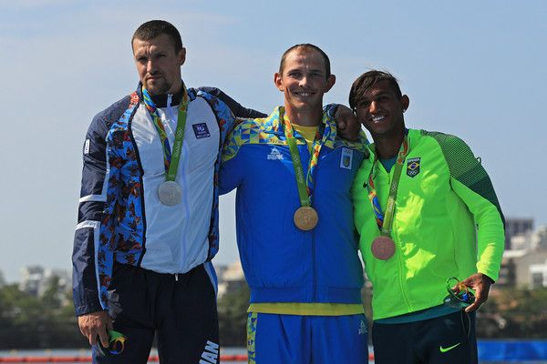 (L-R) Silver medalist Valentin Demyanenko of Azerbaijan, gold medalist Iurii Cheban of Ukraine and bronze medalist Isaquias Queiroz dos Santos of Brazil stand on the podium during the medal ceremony for the Men's Canoe Single 200m event at the Lagoa Stadium on Day 13 of the 2016 Rio Olympic Games on August 18, 2016 in Rio de Janeiro, Brazil.