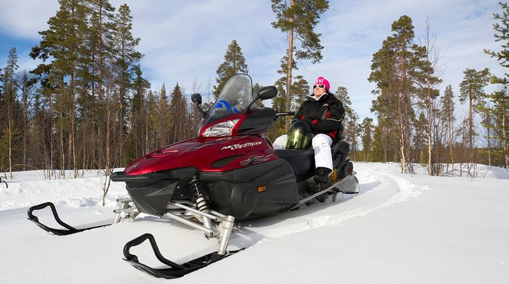 Snowmobiling in Pello in Lapland Finland