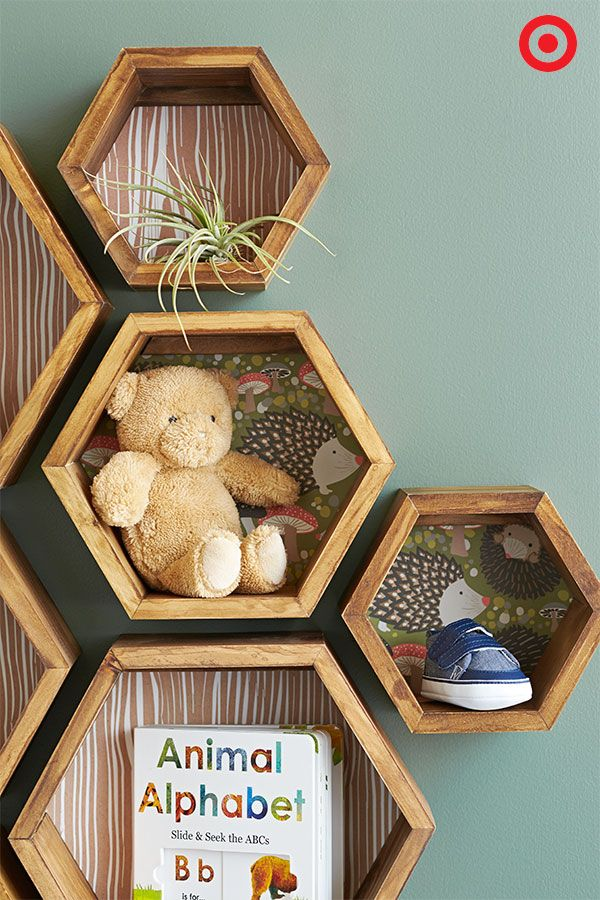 Achieve shelving success with the unique Threshold Hexagon Wall Cubes. This set of three cubes can be used alone, or create a bold statement using multiple sets. Another fun way to customize these cubes? Add colorful or patterned paper to the back to make them really pop off the wall! Consider this little DIY done.