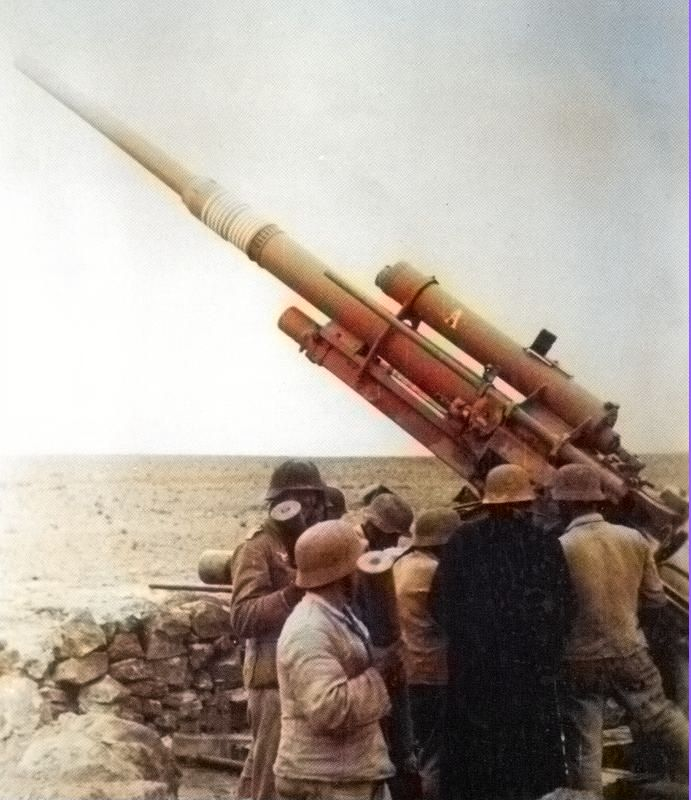 Colorized photo of an Afrika Korps 88mm crew preparing their cannon.