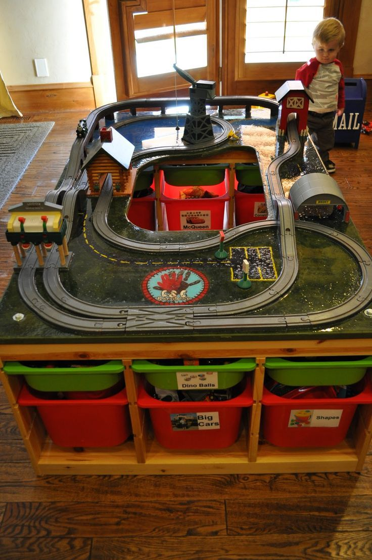 """View #2 -   Home made thomas train table with ikea storage bins as legs...Brilliant...we are in the process of making one for Easton from """"Santa Claus"""":"""