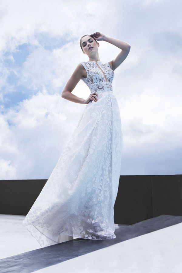 Ivory Princess line gown with a square neckline made from a combination of Chantilly and Rebrode lace