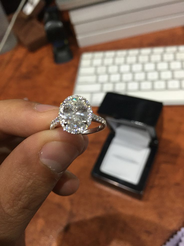 2ct oval cut halo ring set in platinum